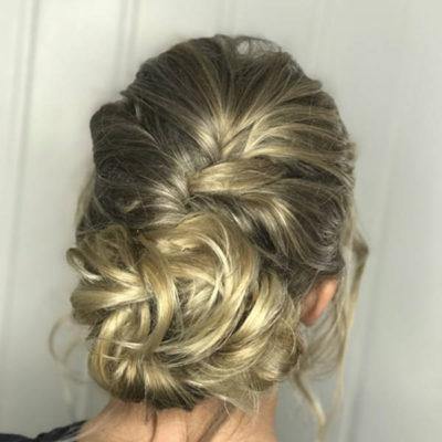 Blonde messy bun with braid